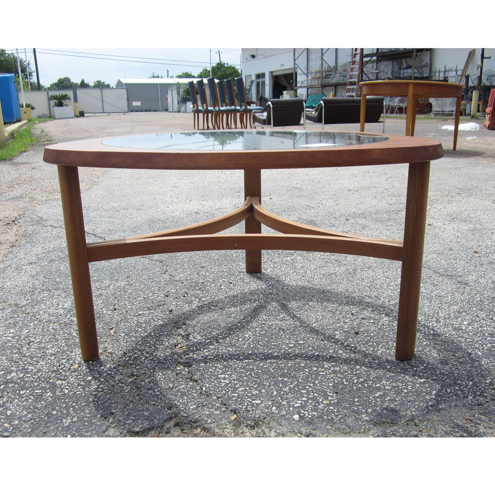 Midcentury retro style modern architectural vintage furniture from mid century modern teak coffee table with glass top this table is triangle in shape with contrasting colors and teak legs its glass top showcases its geotapseo Image collections