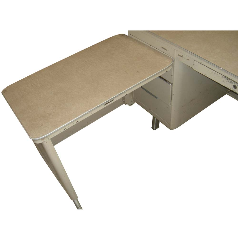 white formica top the desk features four drawers on both sides one
