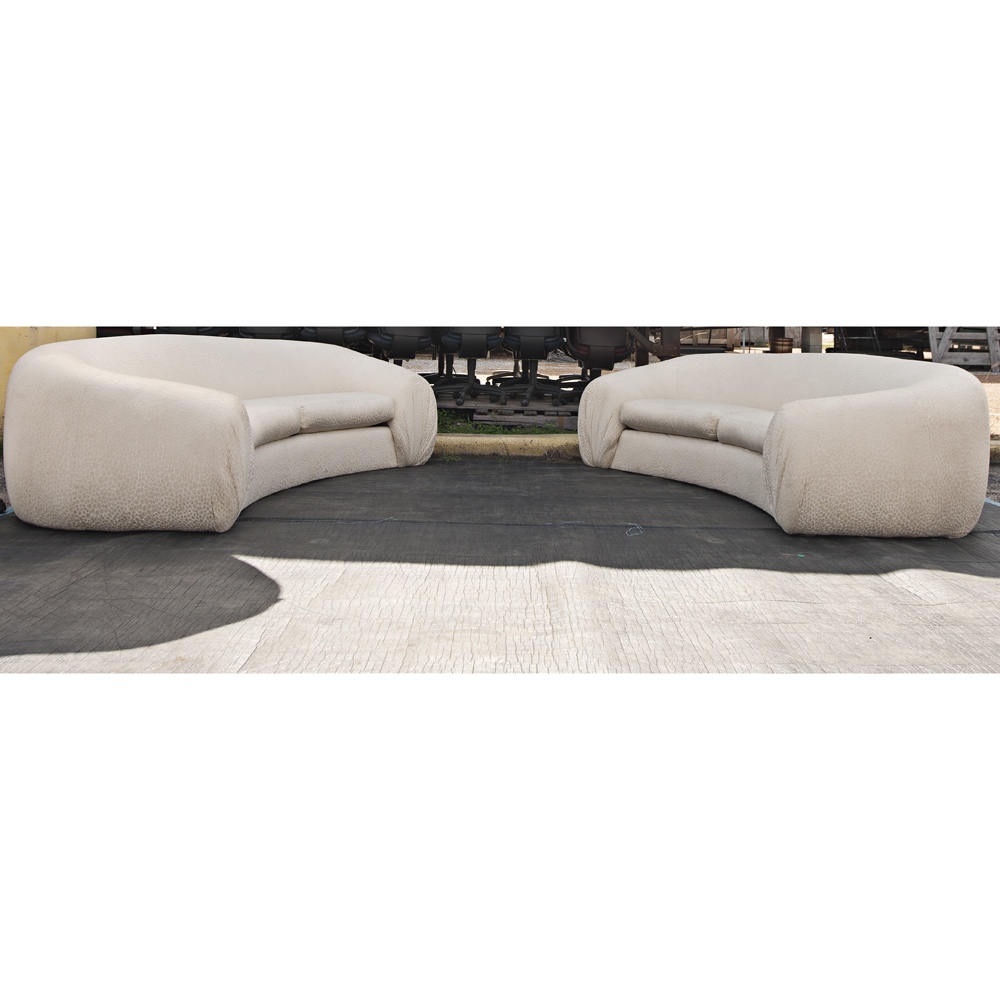 round white directional sofas one sofa is left facing the second sofa