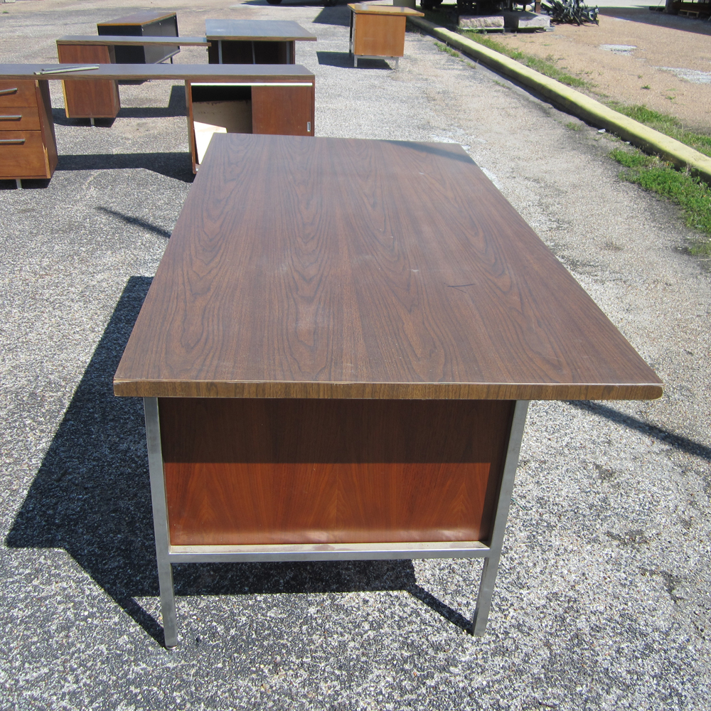 A Vintage Single Pedestal Walnut Desk With Legs And Frame Of Polished Aluminum The Has Two Drawers That Slide Open Metal Handles